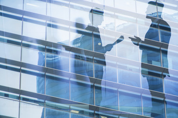Businessmen that work together in office. Concept of teamwork and partnership. double exposure
