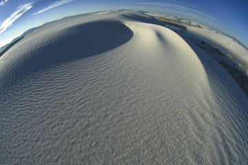 Swirling ridges and textured patterns of sand accentuate a more global perspective of White Sands National Monument.