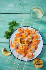 grilled shrimp skewers on wooden surface