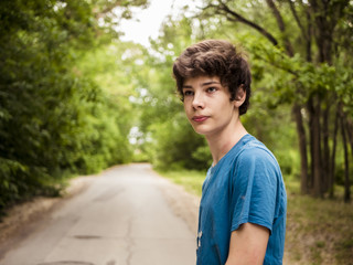 young hipster teenager walking on the alley