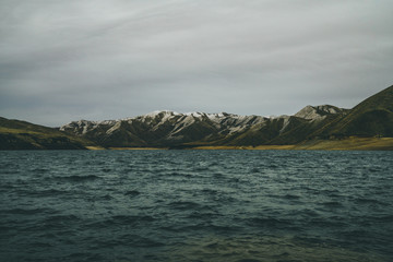 Lucky Peak Idaho with snow and rough waters