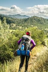 Female backpacker in Henry Coe State Park, CA