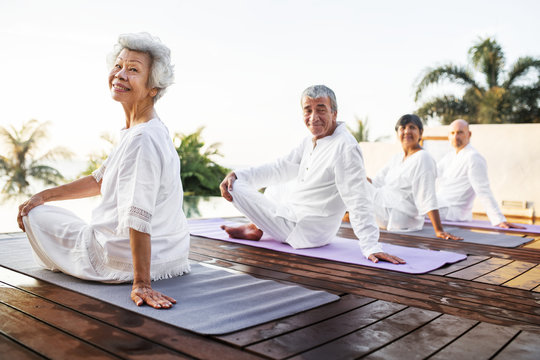 Group of seniors practicing yoga