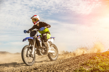 Professional Motocross Motorcycle Rider Drives Through Smoke and Mist Over the Dirt Road Track. Wall mural