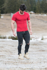 Portrait of Muscular Man Standing Outdoors in Nature