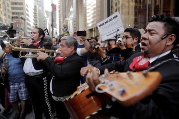 A mariachi band takes part in a protest against U.S. President Donald Trump outside of a hotel where he will meet donors in New York