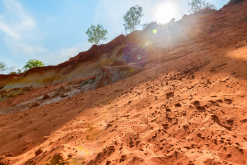 Red dune and red sand pattern with sunlight at Fairy Stream.