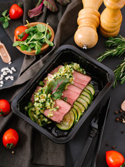 Close-up view of delicious baked meat and fresh vegetables