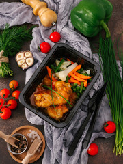 Close-up view of tasty fried chicken meat and steamed vegetables