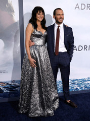 """Cast members Woodley and Claflin pose at the premiere for the movie """"Adrift"""" in Los Angeles"""