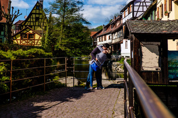 Couple in romantic embrace in beautiful surroundings in Kaysersberg, Alsace.