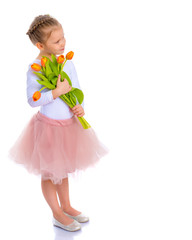Little girl with a bouquet of tulips.