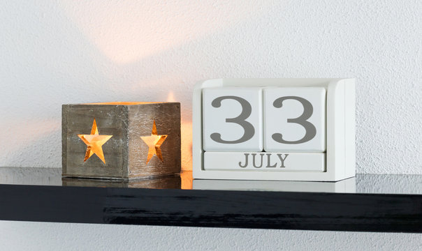 White block calendar present date 33 and month July - Extra day