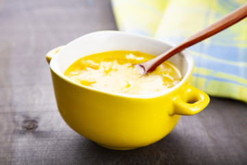 Cheese soup in a yellow plate