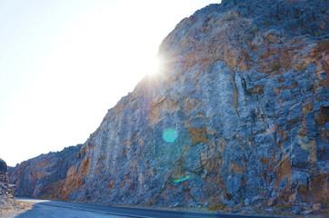 Mountain slope illuminated by sunlight