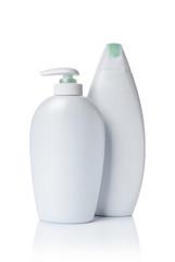Blank white mockup dispenser bottles of cosmetic product