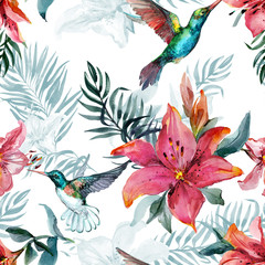 Beautiful colorful flying hummingbirds and red lily flowers on white background. Exotic tropical seamless pattern. Watecolor painting. Hand painted illustration.