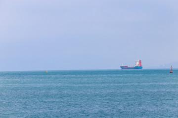 Cargo ship on the horizon at Black sea
