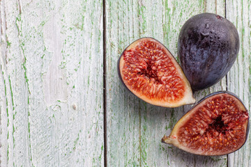 Group of fig halves on a white rustic table