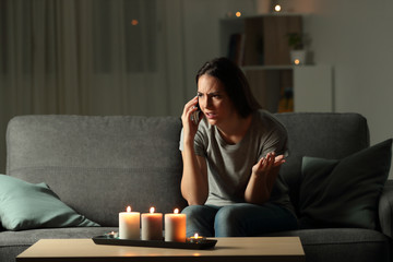 Woman calling insurance in the night after blackout