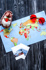 accessories for treveling with children, map and photos on dark