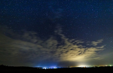 Starry sky and illuminated clouds.