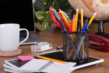 Assortment of Office Supplies on a Desktop