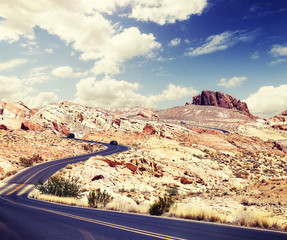Scenic desert road, travel concept, color toned picture.