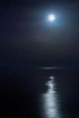 Full moon of August over a calm sea. Portrait orientation Fine Art