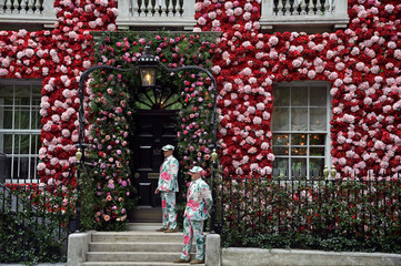 Doormen dressed in floral pattern suits stand on duty outside of Annabel's private members club, adorned with thousands of flowers, timed to coincide with the RHS Chelsea Flower Show, in Mayfair in London, Britain