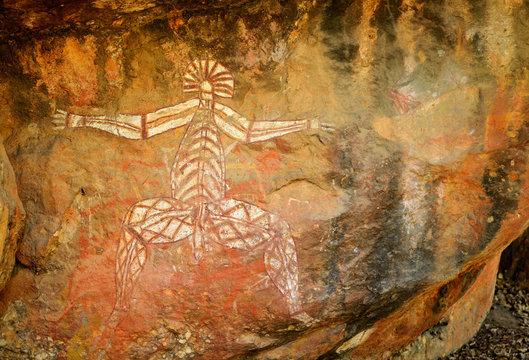 Ancient aboriginal painting of man art on huge rock stone in Kakadu park, northern territory, Australia.
