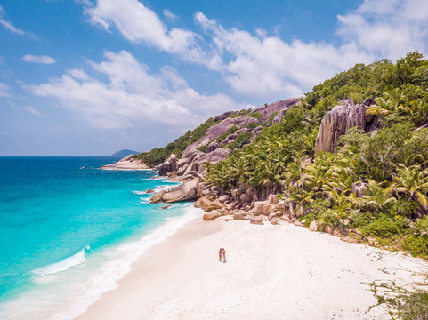 couple man and woman drone view from above Seychelles tropical island