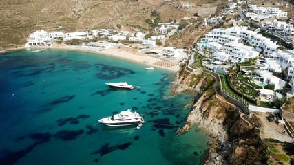 Aerial drone photo of famous turquoise clear water beach of Psarou in iconic island of Mykonos, Cyclades, Greece