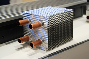 Picture of an aluminum radiator. Radiator cooling with copper branch pipes.