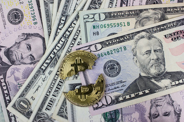 Broken bitcoin, cryptocurrency falling. USA dollar banknotes