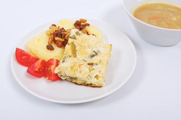 Baked leek with mashed potatoes on a white
