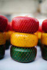 Gouda cheese rolls on sale in red, yellow and green