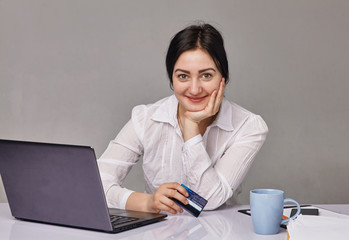 Portrait of pretty  young woman working in office