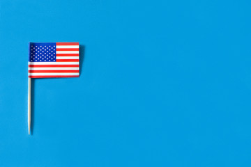 USA flag pattern on blue background. Copyspace
