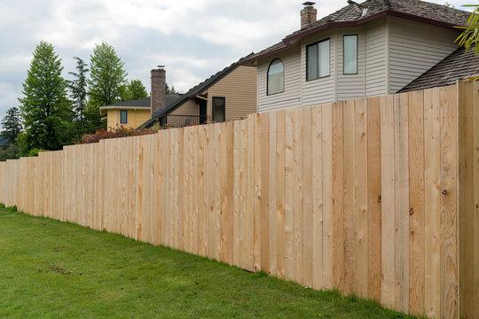 Cedar Wood Fencing along Home Backyard