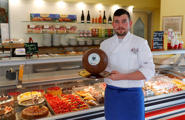 Confectioner Pertoll presents a chocolate ball with the German national soccer team logo in Eppan