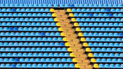 Yellow and blue plastic seats in the stadium