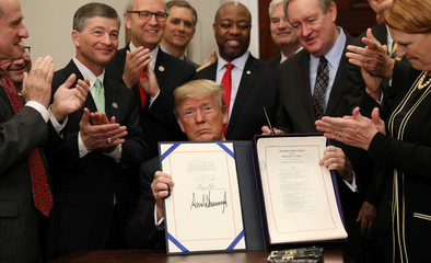 Trump signs  S. 2155 - Economic Growth, Regulatory Relief, and Consumer Protection Act,  at the White House in Washington