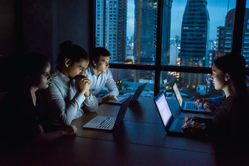businesspeople working overtime in nighttime at the office.