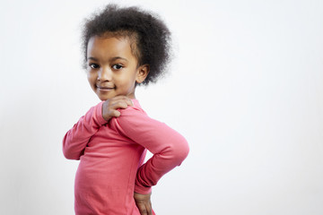 Portrait of smiling girl standing against white background