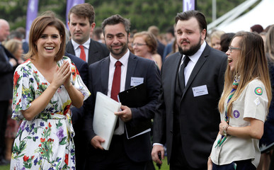 Britain's Princess Eugenie, left, laughs as she meets actor John Bradley, second right, during a day of DofE presentations at Buckingham Palace in London