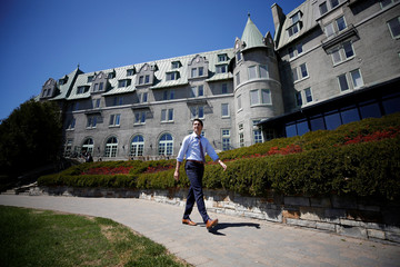 Canada's PM Trudeau walks outside the Manoir Richelieu in La Malbaie