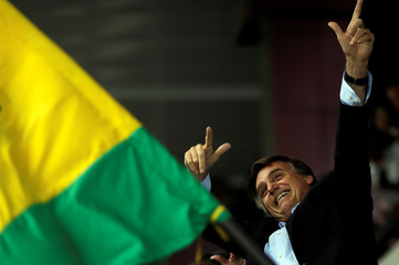 Federal deputy Jair Bolsonaro, a pre-candidate for Brazil's presidential election, waves to supporters as he arrives at Luis Eduardo Magalhaes International Airport in Salvador