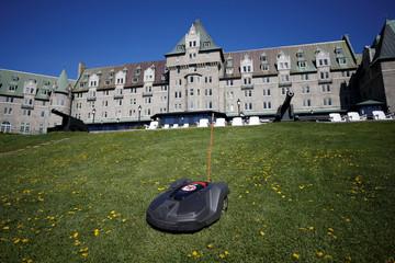A Husqvarna Automower robotic lawn mower cuts grass outside the Manoir Richelieu in Quebec's Charlevoix region