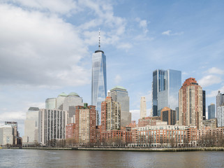 Modern buildings by Hudson river against sky